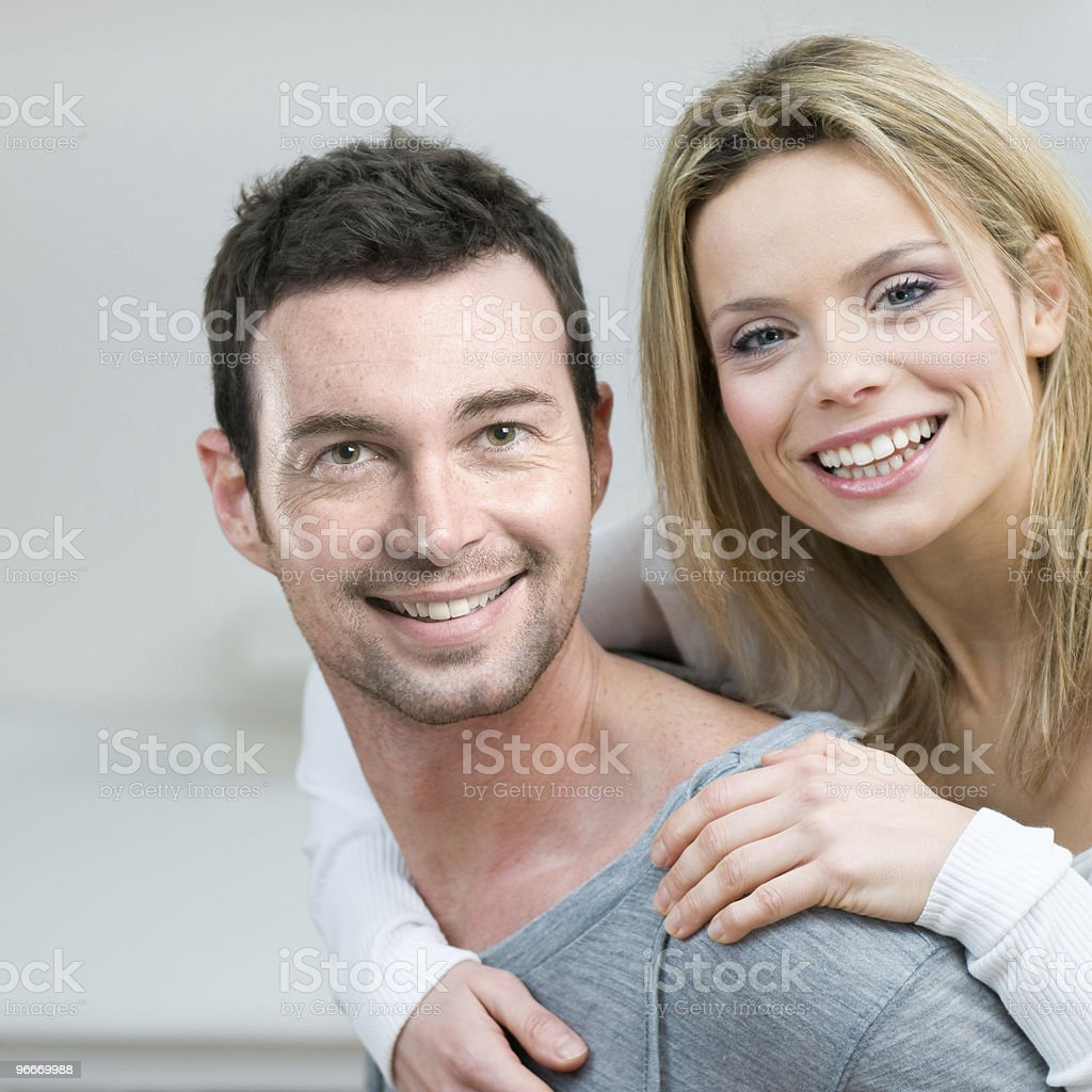 Young couple piggyback at home royalty-free stock photo