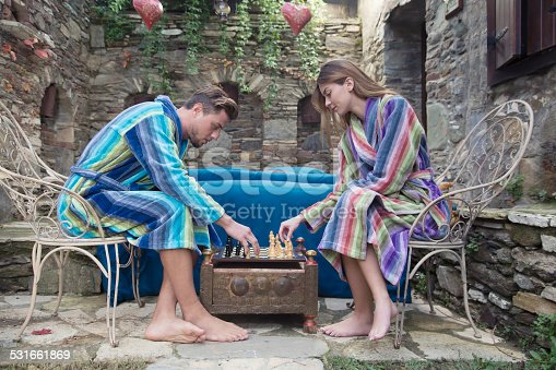 536952169 istock photo Young couple play chess 531661869