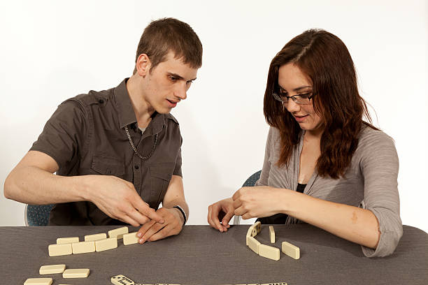 Young couple playing dominos stock photo