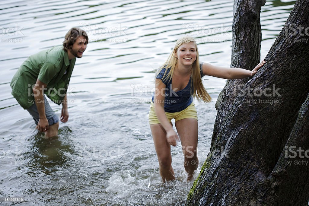 Young Couple Playing in Water royalty-free stock photo