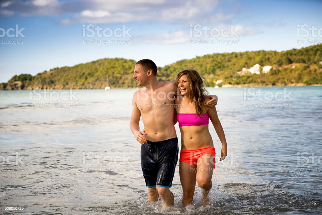 Young Couple Playing in Water stock photo