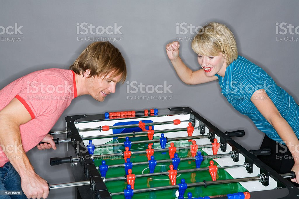 Young couple playing table football 免版稅 stock photo