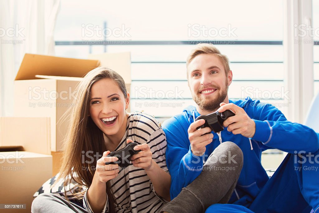 Young couple playing video games stock photo