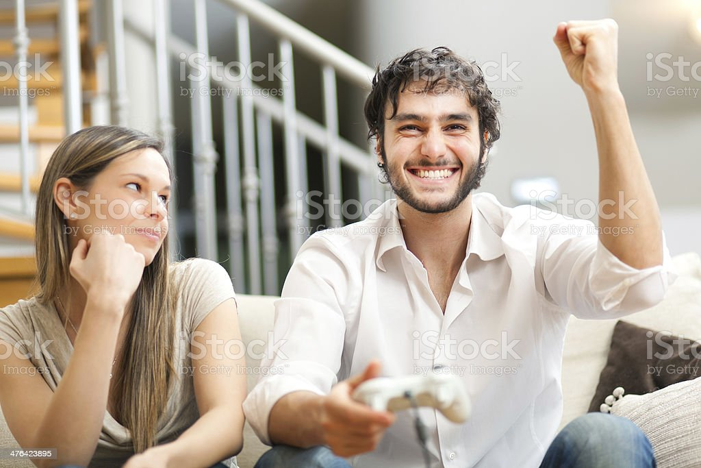 Young couple playing videogames royalty-free stock photo
