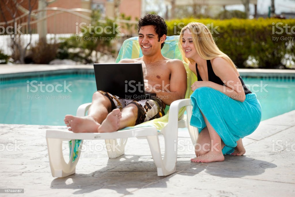 Young Couple Poolside royalty-free stock photo