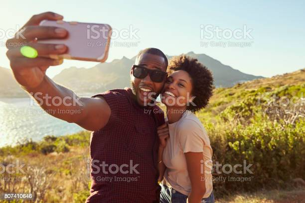 Young couple pose for holiday selfie on clifftop picture id807410646?b=1&k=6&m=807410646&s=612x612&h=0va0lfbyn3vyhpbbppu28aqsq67nyp5rwtar9 fglzc=