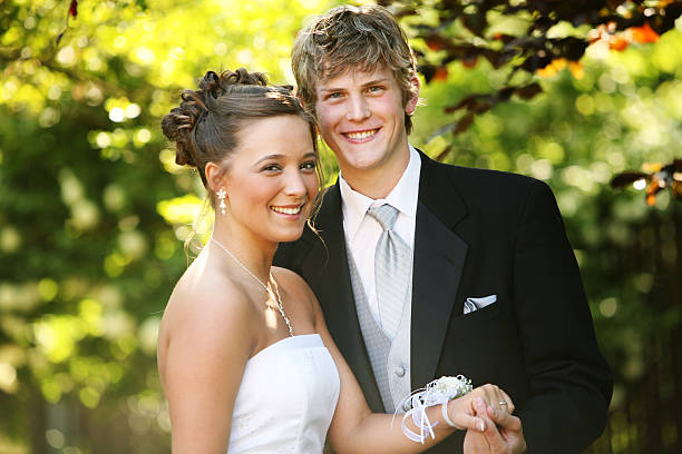 young couple posing for prom photos - prom stock photos and pictures