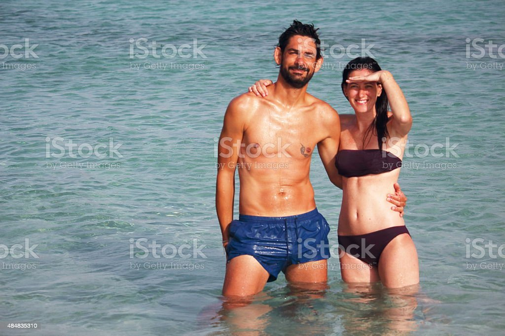 Young couple posing in front of the camera in Formentera stock photo
