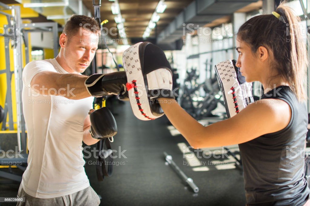 Young couple practicing boxing together in gym. stock photo