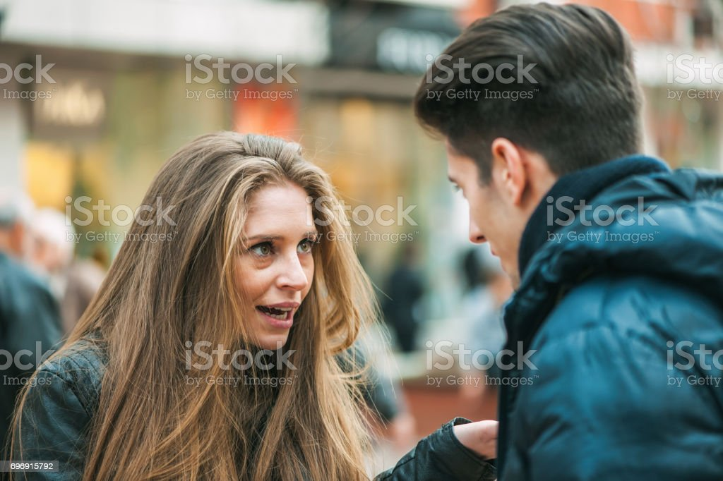 Young couple quarreling because of disagreements stock photo
