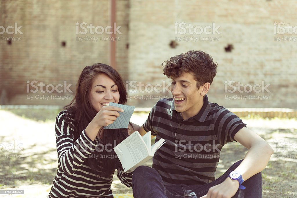 young couple reading book in park royalty-free stock photo