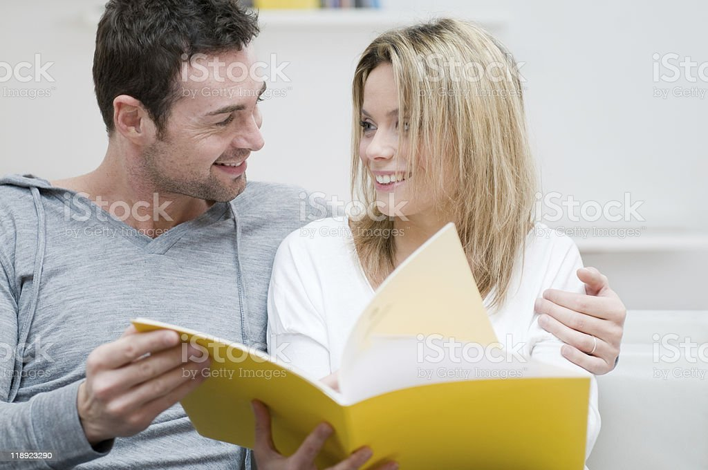 Young couple reading magazine with love royalty-free stock photo