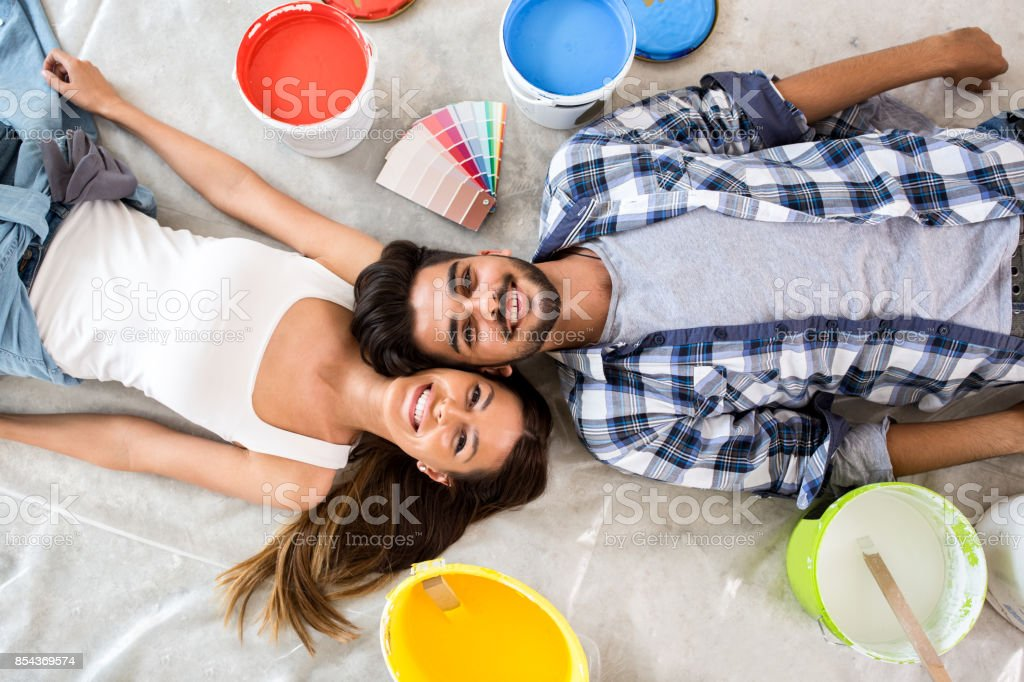 Young couple ready for renovation stock photo