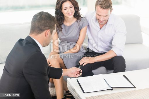 istock Young couple ready to buy new house 674976928