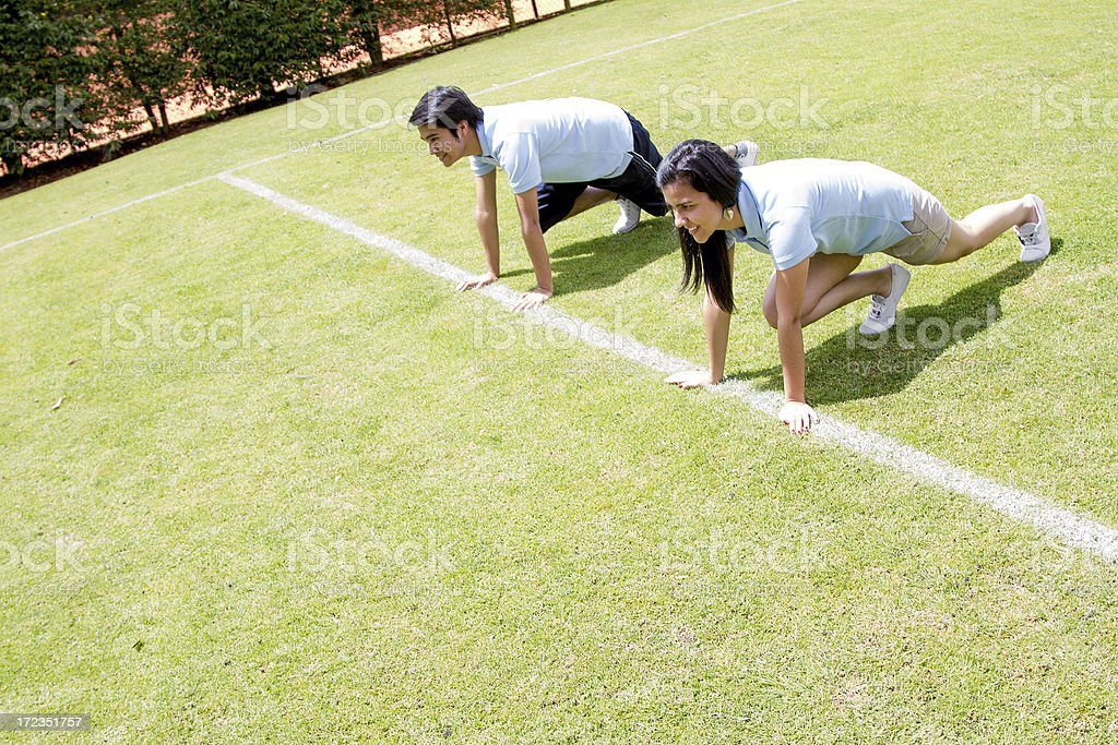Young couple ready to race royalty-free stock photo