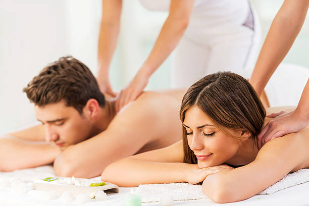 Young couple receiving back massage. stock photo