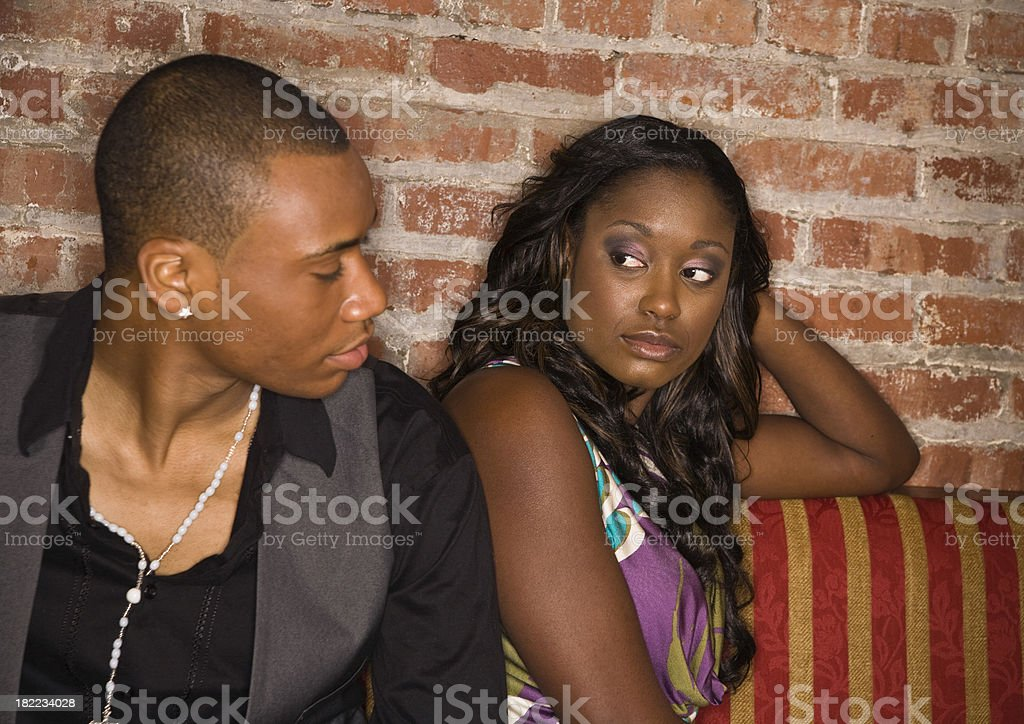 Young couple - Relationship Problems [looking at each other] royalty-free stock photo