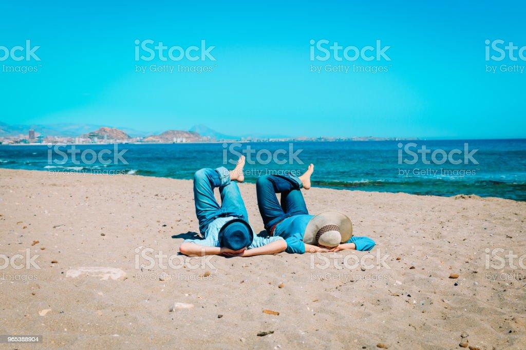 young couple relax having fun on beach zbiór zdjęć royalty-free