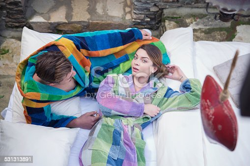 536952169 istock photo Young couple relax in garden 531313891