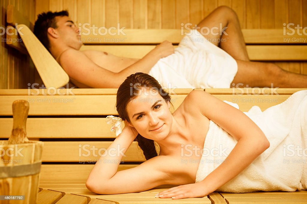 Young Couple Relaxing at Health Spa Sauna stock photo
