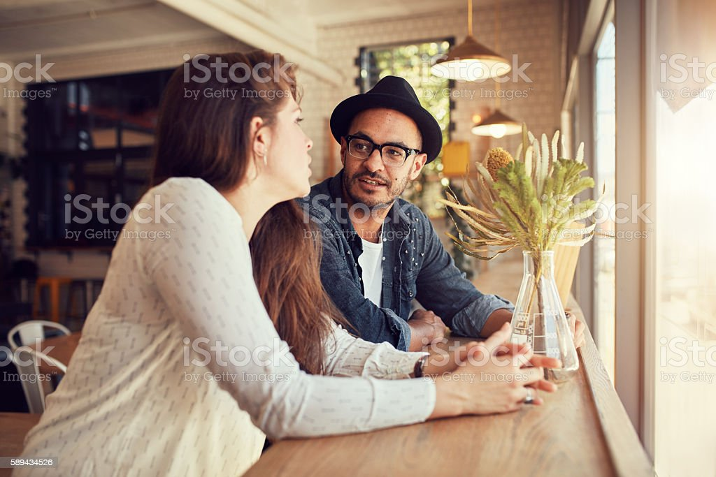 Young couple relaxing in a coffee shop. stock photo