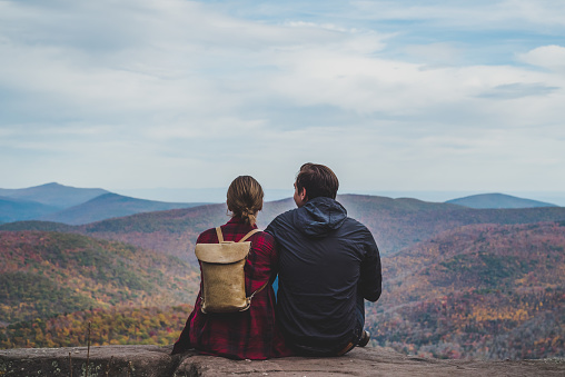 A beautiful shot of a couple relaxing in nature in autumn when the colors are changing.