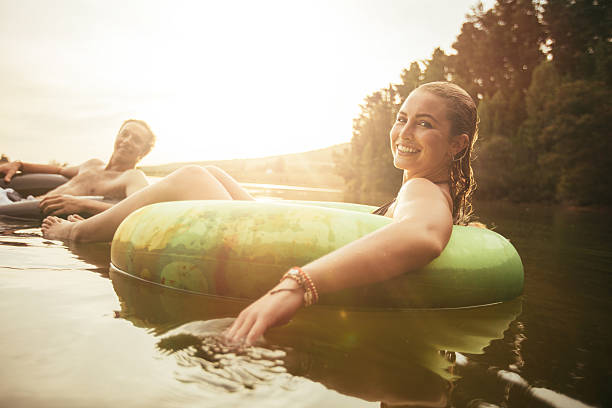 Young couple relaxing in water on a summer day stock photo