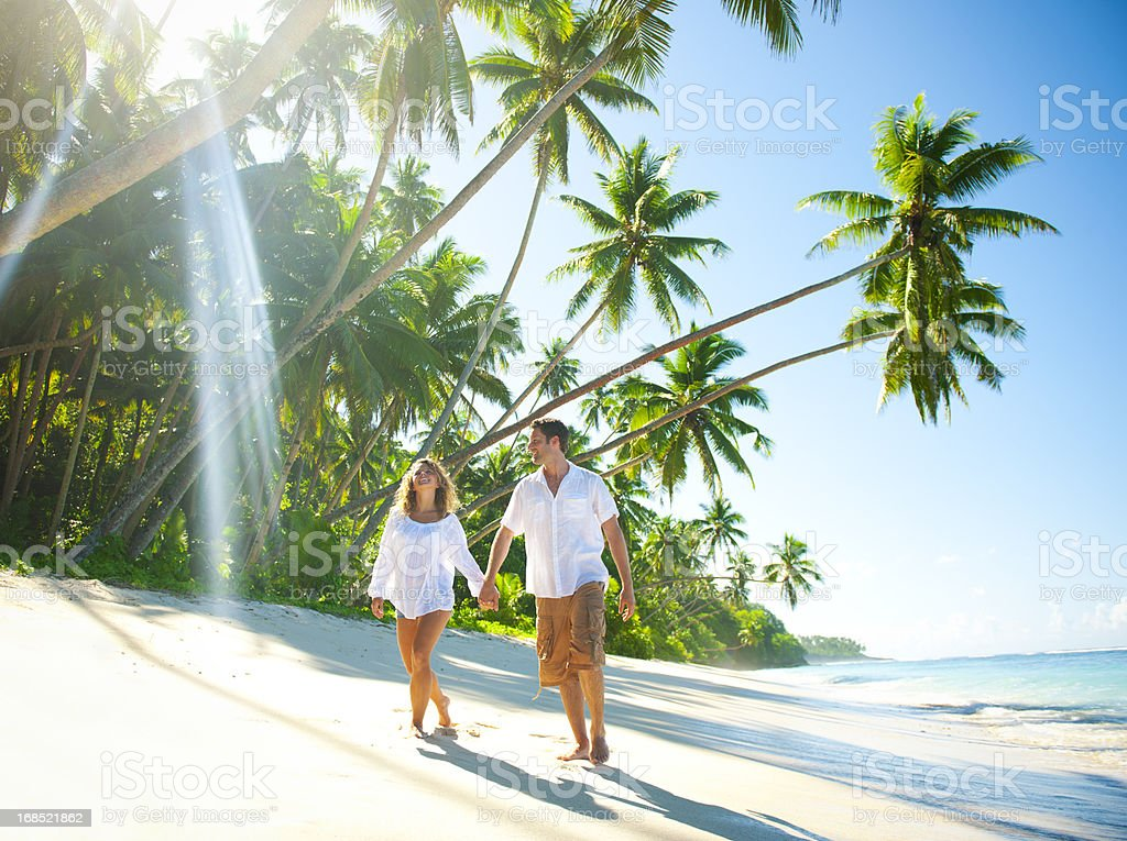 Young Couple relaxing on an idyllic tropical beach royalty-free stock photo