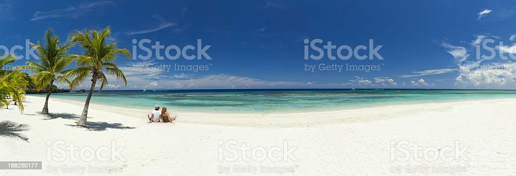 Young couple relaxing on beach stock photo