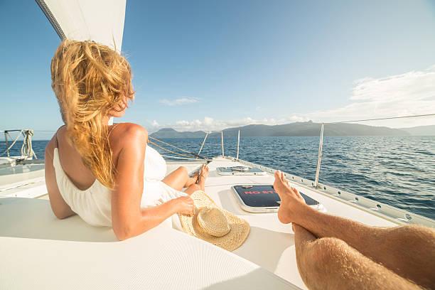 young couple relaxing on sailing boat - katamaran bildbanksfoton och bilder