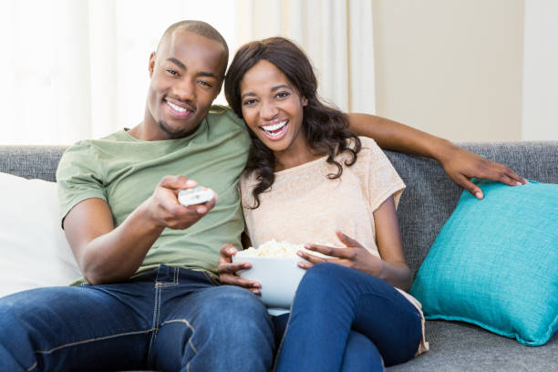 Young couple relaxing on the sofa stock photo