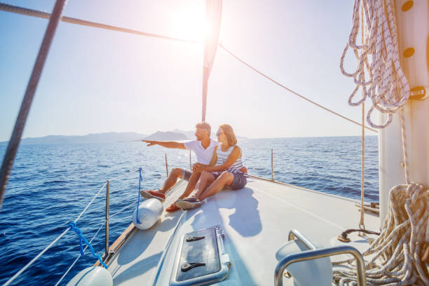 young couple relaxing on the yacht - enjoying wealthy life imagens e fotografias de stock