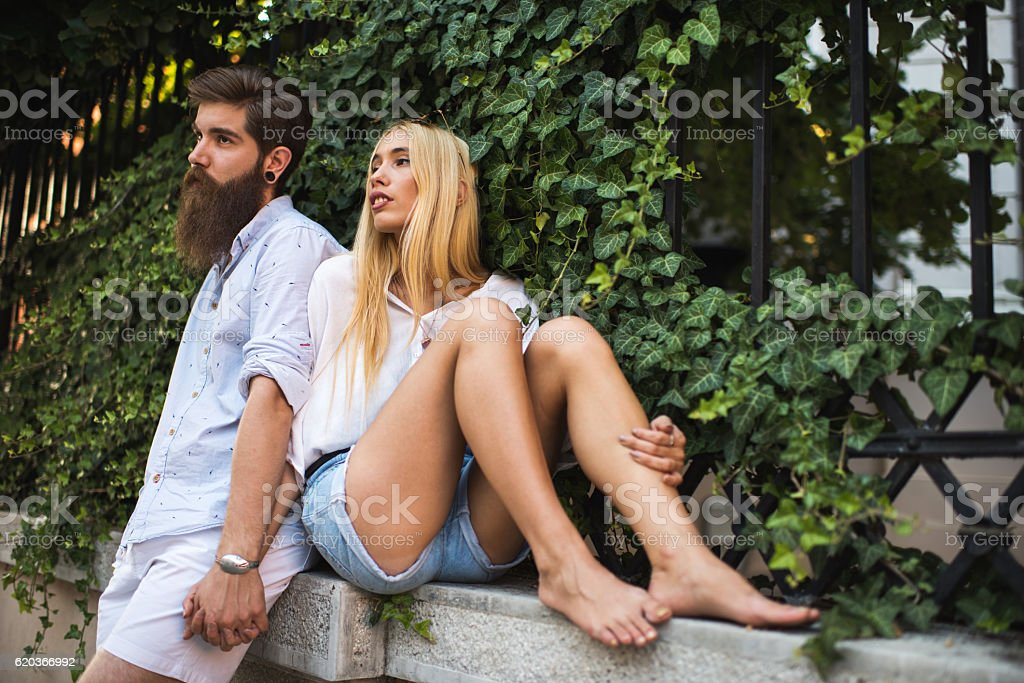 Young couple relaxing together by the fence. zbiór zdjęć royalty-free