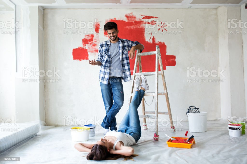 Young couple renovating their house stock photo