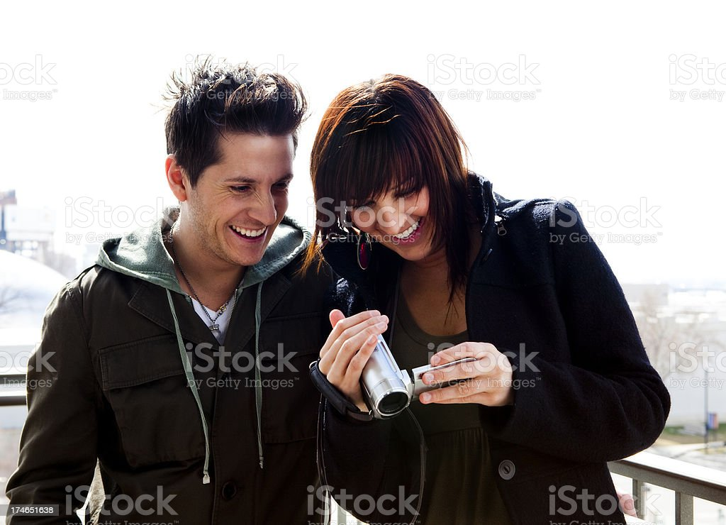 Young Couple Reviewing Video on Camcorder royalty-free stock photo