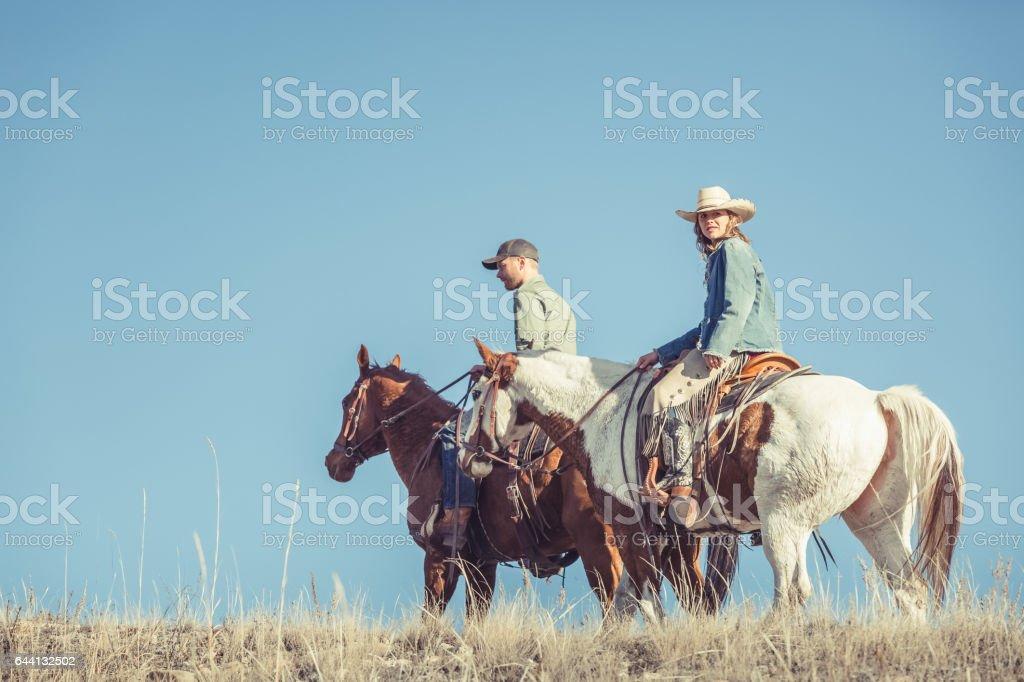 Young Couple Riding Horseback royalty-free stock photo