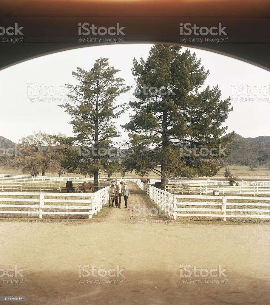 Young couple romancing at ranch royalty-free stock photo