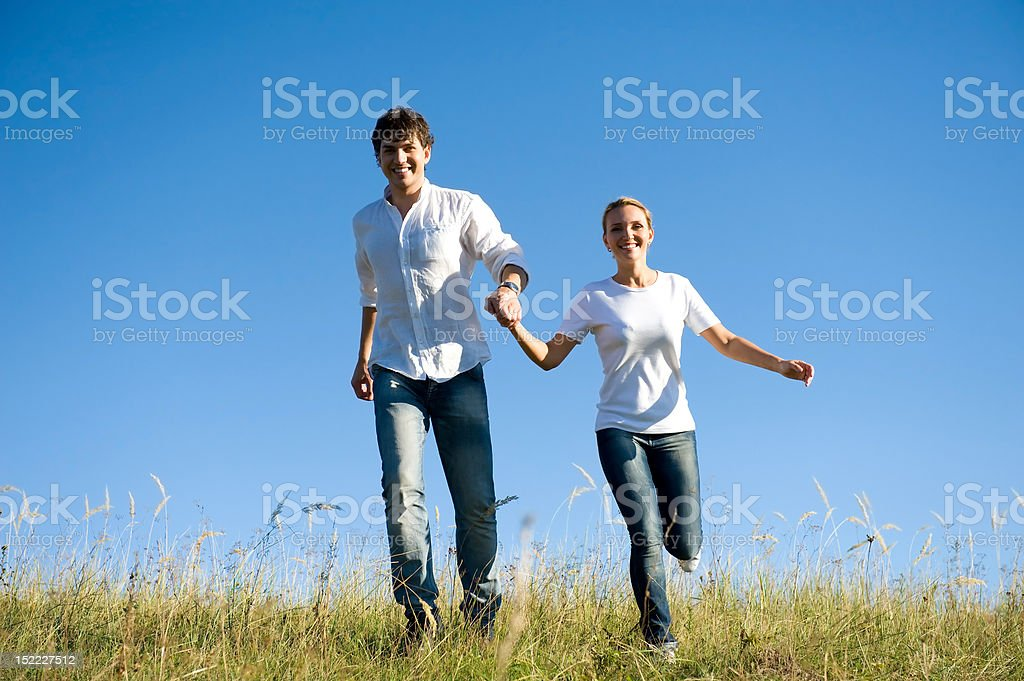 young couple running royalty-free stock photo