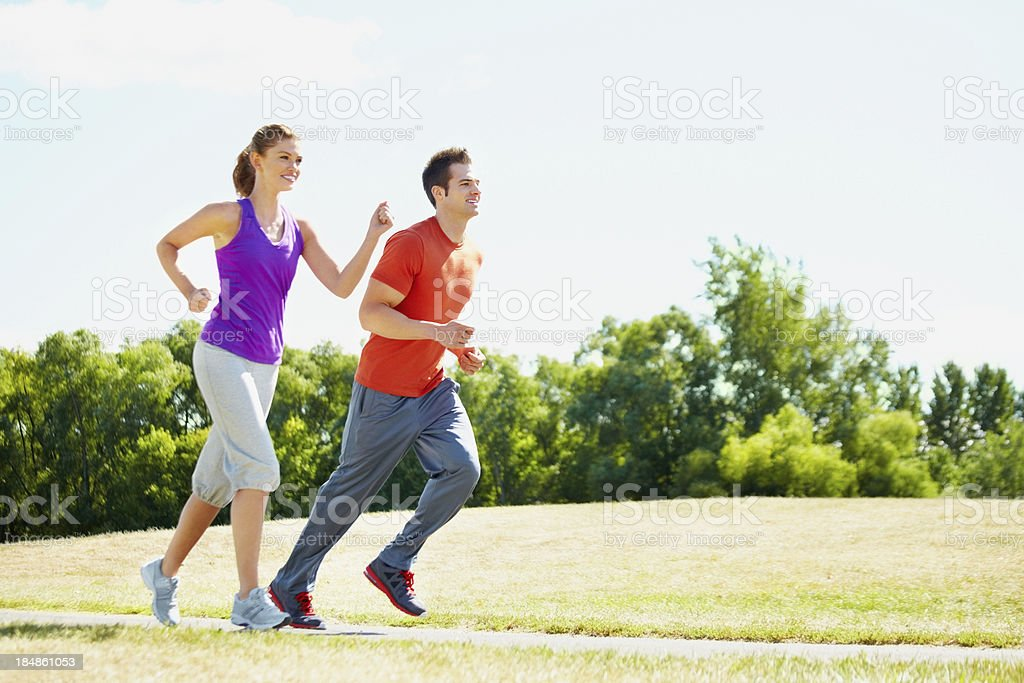 Young couple running together royalty-free stock photo