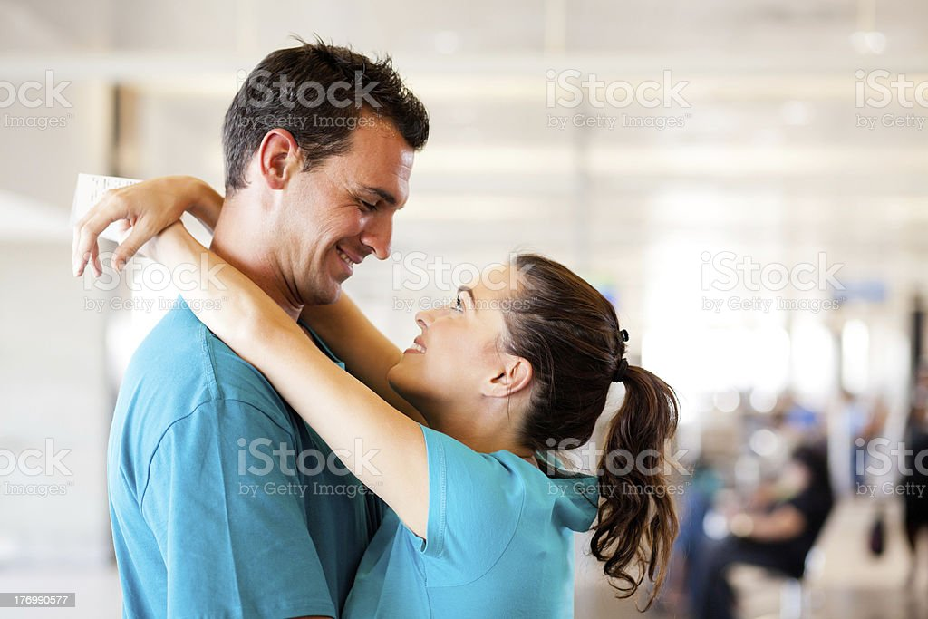 young couple say good bye at airport royalty-free stock photo