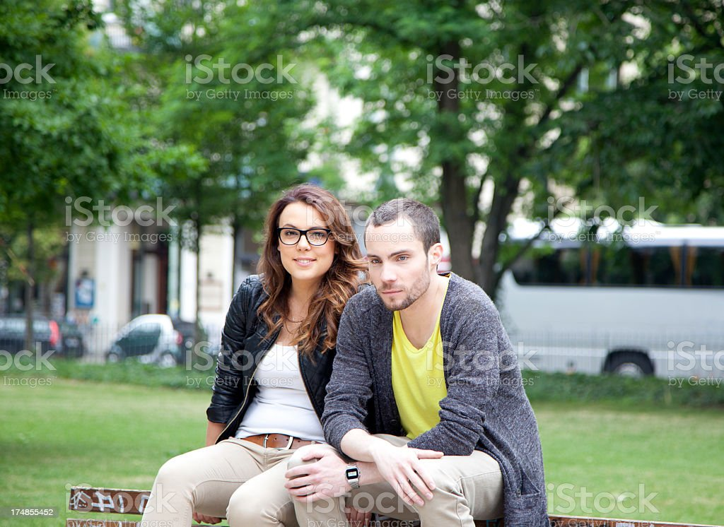 young couple seated at the park royalty-free stock photo