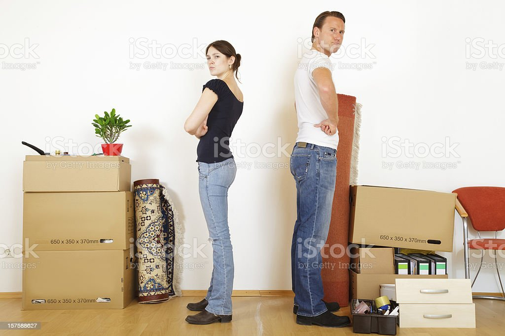 young couple separating stock photo