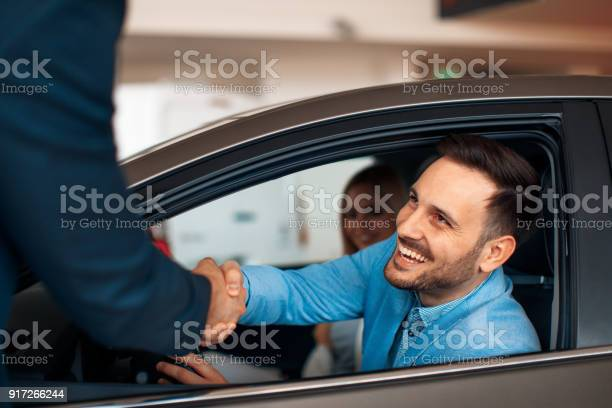 Young couple shaking hands after a successful car buying picture id917266244?b=1&k=6&m=917266244&s=612x612&h=suzer73xkydu2avsoxsjrt060ph6h4bqe8ki7tfxhs0=