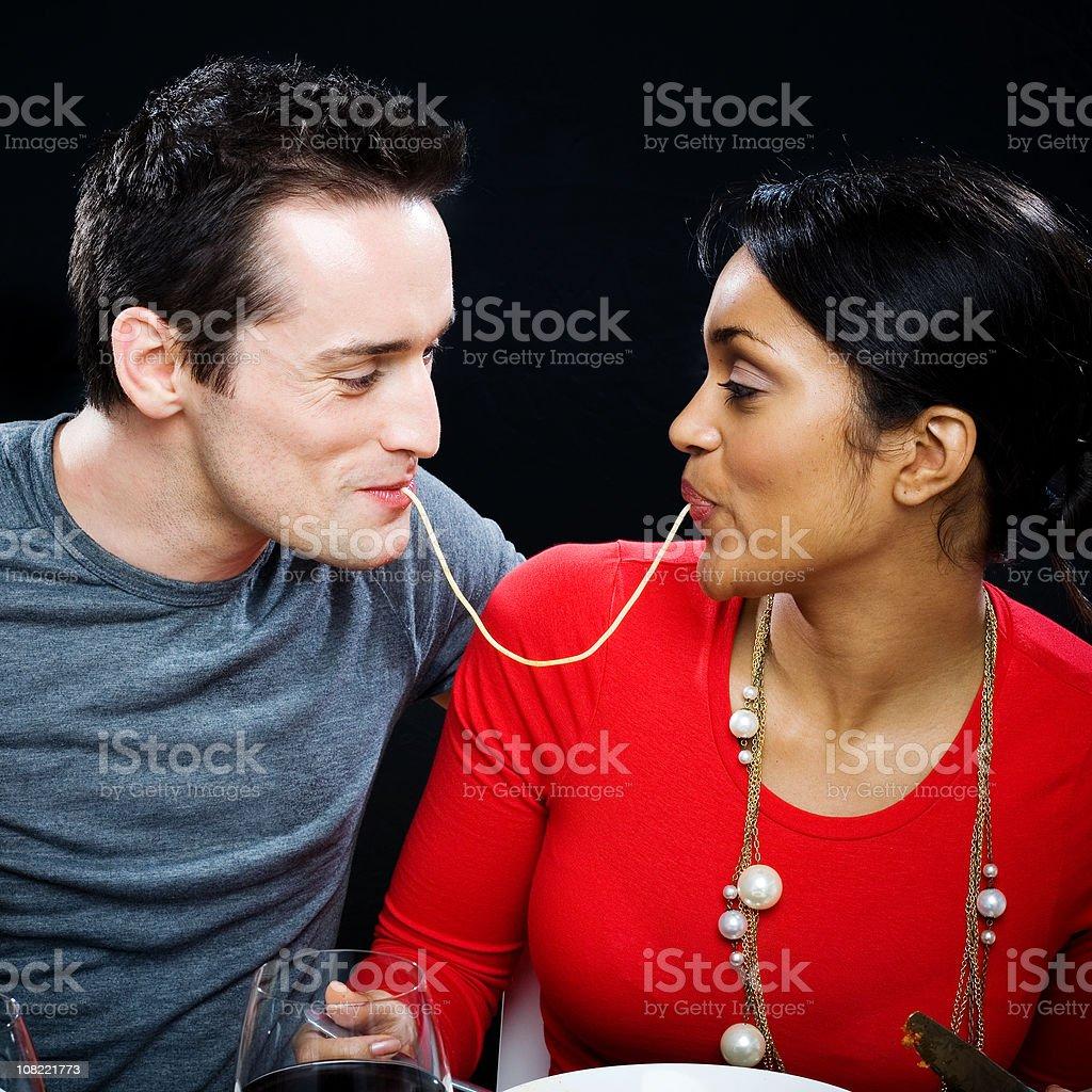 Young Couple Sharing Spaghetti stock photo
