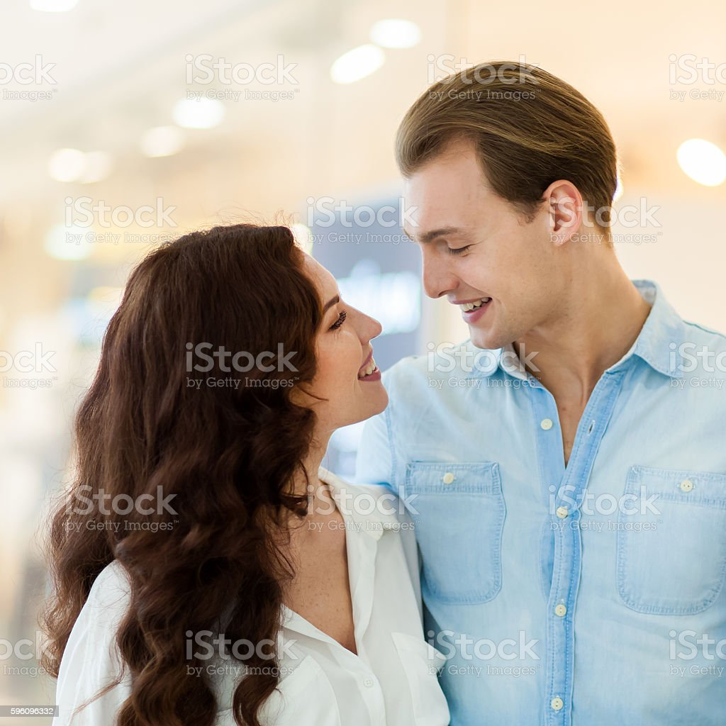 Young couple shopping and having fun together royalty-free stock photo