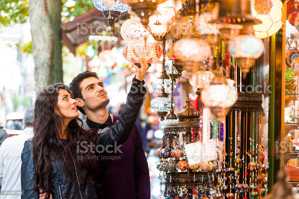 Young Couple Shopping for Goods in Street Bazaar stock photo