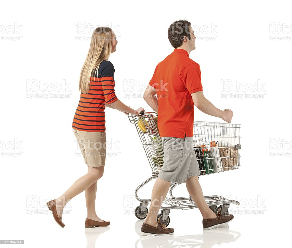 Young couple shopping in a supermarket royalty-free stock photo