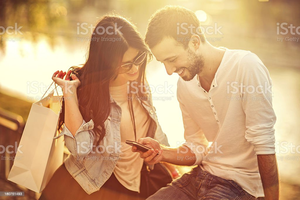 Young couple shopping online with smartphone royalty-free stock photo