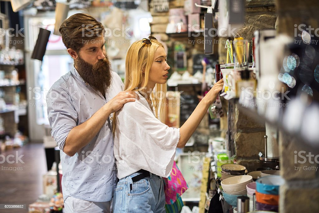 Young couple shopping together in a store. zbiór zdjęć royalty-free