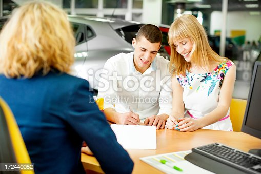 istock Young Couple Signing Contract. 172440082